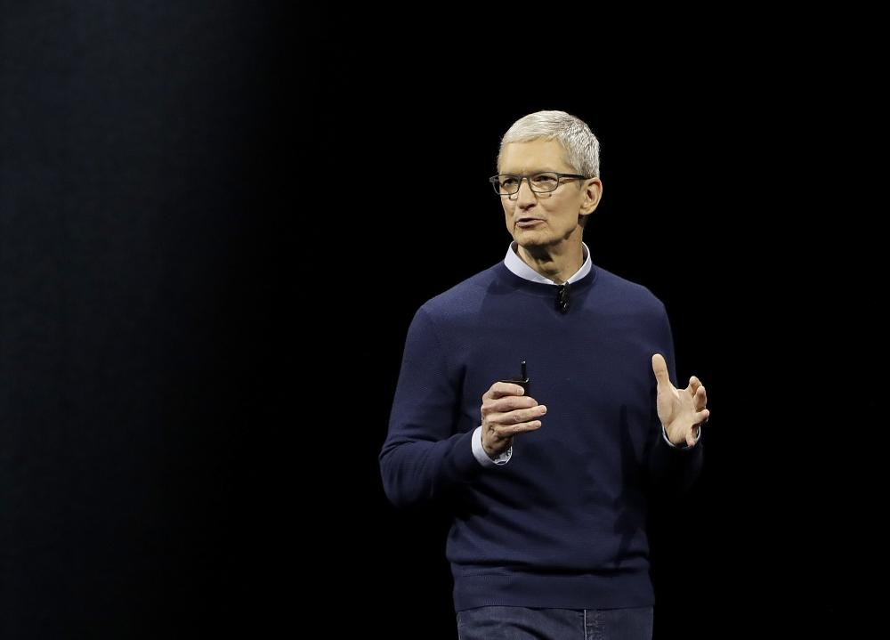 In this file photo, Apple CEO Tim Cook speaks during an announcement of new products at the Apple Worldwide Developers Conference in San Jose, Calif. Apple is donating $2 million to two human rights groups as part of CEO Tim Cook's pledge to help lead the fight against the hate that fueled the violence in Charlottesville, Va., during a white-nationalist rally. Cook made the commitment late Wednesday in an internal memo obtained by The Associated Press. — AP