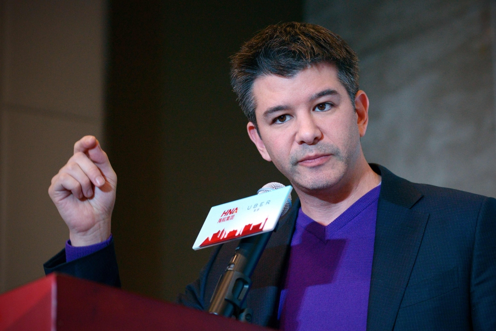 This file photo  shows Travis Kalanick,former CEO of the global ridesharing service Uber, during a press conference in Beijing. Uber's ousted chief executive and company founder Travis Kalanick is asking for the dismissal of an investor lawsuit against him, calling it part of a personal attack aimed at sidelining him. — AFP