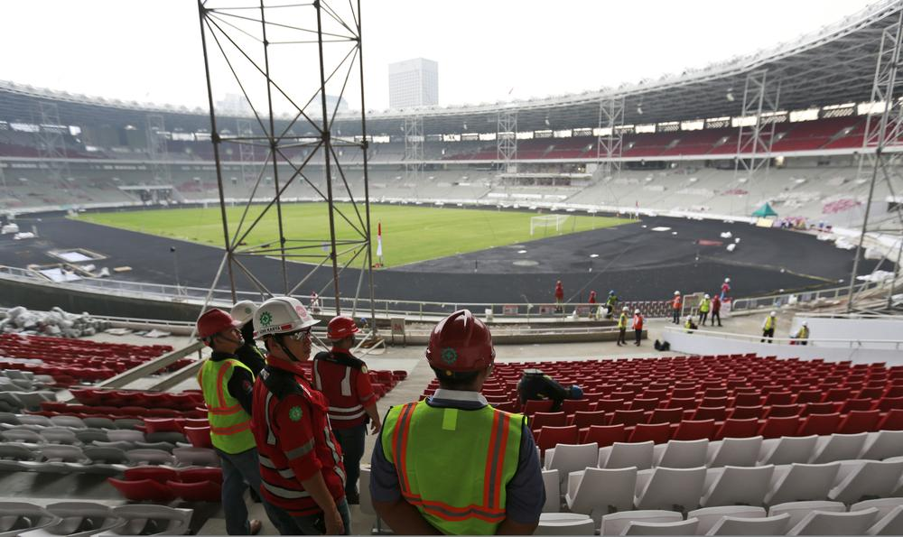 In this Tuesday photo, safety officers inspect the renovation of Gelora Bung Karno Main Stadium in Jakarta, Indonesia. Indonesia starts a one-year countdown clock on Friday as it races to complete venues for the 18th Asian Games that it hopes will showcase the archipelago as a leading nation in the region and boost its perennially light medal haul. — AP
