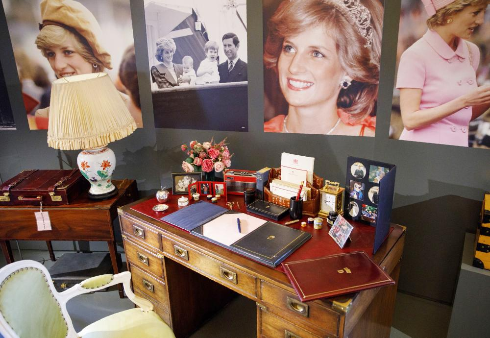 The desk at which Britain's Diana, Princess of Wales, worked at whilst in residence at Kensington Palace, along with a selection of her personal artefacts, chosen by her sons Prince William, Duke of Cambridge, and Prince Harry, is pictured during a photocall at Buckingham Palace in London, to promote the 'Royal Gifts' exhibition. The exhibition showcases some of the gifts given to the Queen during her 65-year reign. — AFP
