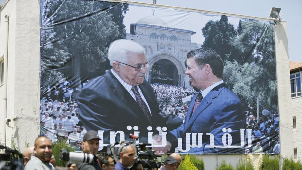Jordan's King Abdullah and Palestinian President Mahmoud Abbas shake hands during a welcome ceremony for the king in Ramallah earlier this month.— AFP