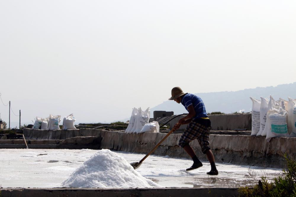 A Lebanese man works at salt evaporation ponds in the coastal Lebanese town of Anfeh north of the capital Beirut. Traditional coastal salt production was once popular in Lebanon, but the fully artisanal practice now survives in just a single seaside town, Anfeh, around 70 km north of Beirut. — AFP