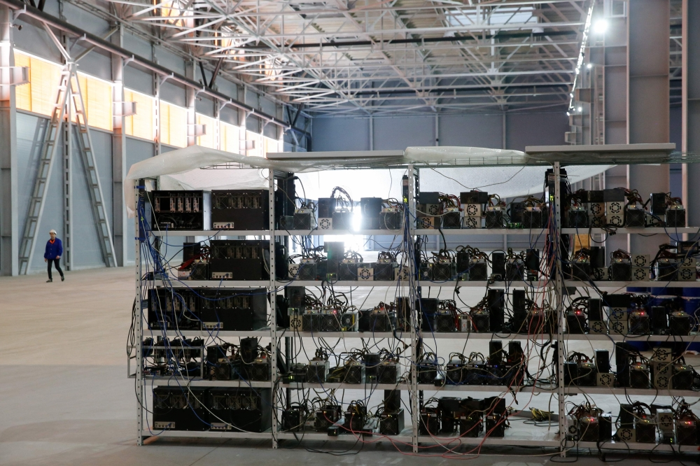 Russia's crypto-businessman Dmitry Marinichev's virtual currencies mining farm operates in a former Soviet-era car factory warehouse in Moscow. — AFP
