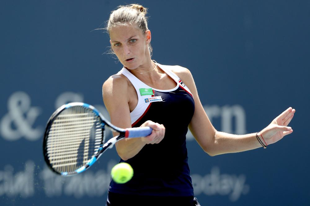 Karolina Pliskova of Czech Republic returns a shot to Camila Giorgi of Italy at the Western & Southern Open in Mason, Ohio, Friday. — AFP