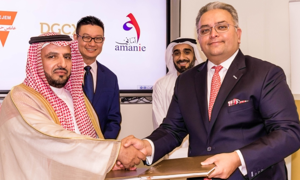 Ayedh Bin Dejem, Chairman of the   Ayedh Dejem Group  and Gaurang Desai, Chief Executive Officer of the DGCX during the signing of contract