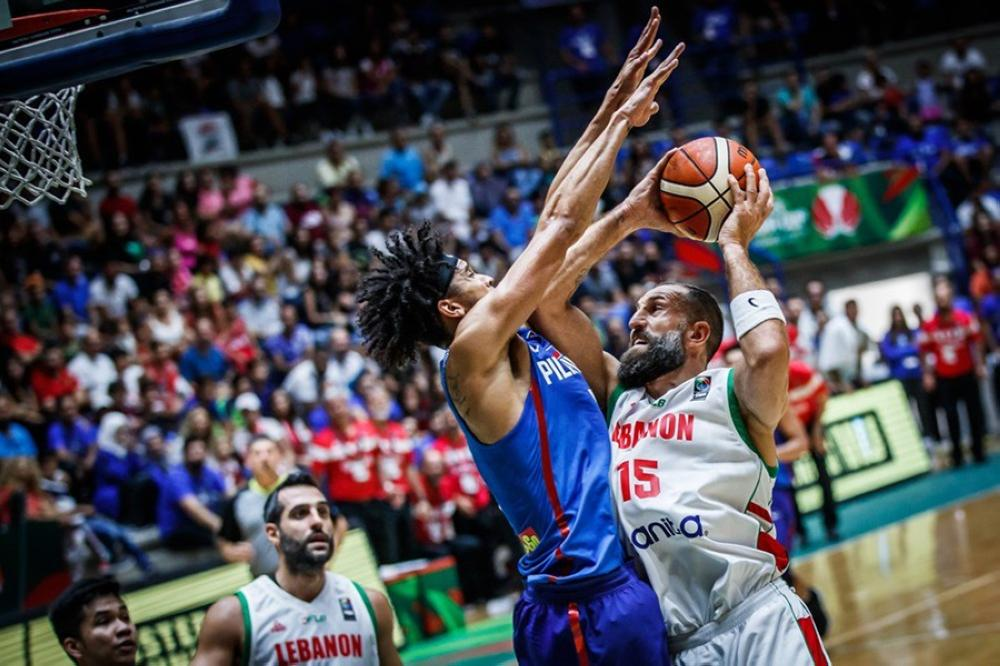 Gilas Pilipinas' Gabe Norwood defends against Lebanon's Fadi El Khatib in the Fiba Asia Cup classification round game at the Nouhad Nawfal Stadium in Beirut, Lebanon Saturday night.