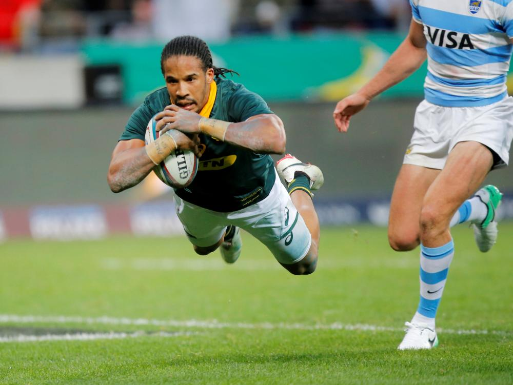 South Africa's Courtnall Skosan scores a try against Argentina during their Rugby Union match at Mandela Bay Stadium, Port Elizabeth, South Africa, Saturday. — Reuters