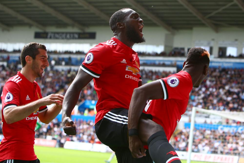 Manchester United's striker Romelu Lukaku (C) and midfielder Paul Pogba (R) celebrate scoring the team's fourth goal during their English Premier League match against Swansea City at The Liberty Stadium in Swansea, south Wales, Saturday. — AFP