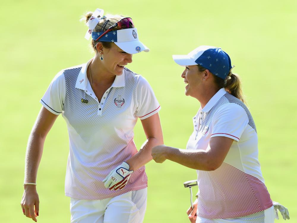 Cristie Kerr (R) of Team USA celebrates her birdie putt with Lexi Thompson to halve the 12th hole with Team Europe during the evening four-ball matches of the Solheim Cup at the Des Moines Golf and Country Club in West Des Moines, Iowa, Saturday. — AFP