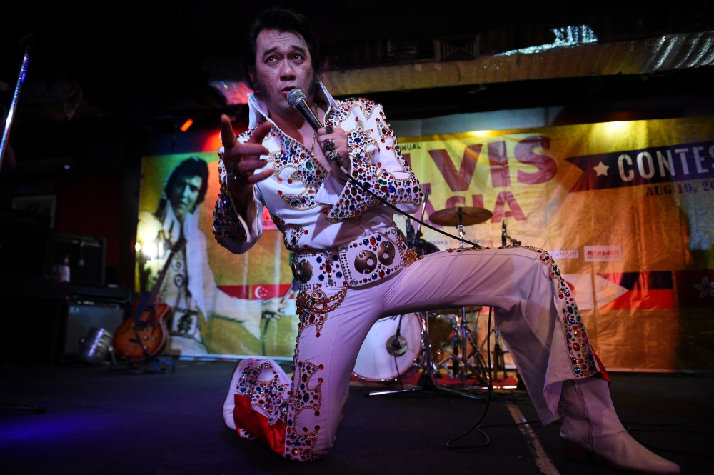 Jun Espinosa of the Philippines, an impersonator of US music legend Elvis Presley, performs during the finals of the first annual Elvis Asia contest in Manila on Saturday. - AFP