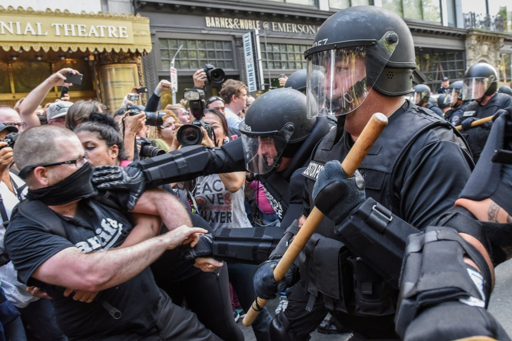 Counter protesters clash with Boston Police outside of the Boston Commons and the Boston Free Speech Rally in Boston, Massachusetts, on Saturday. — Reuters
