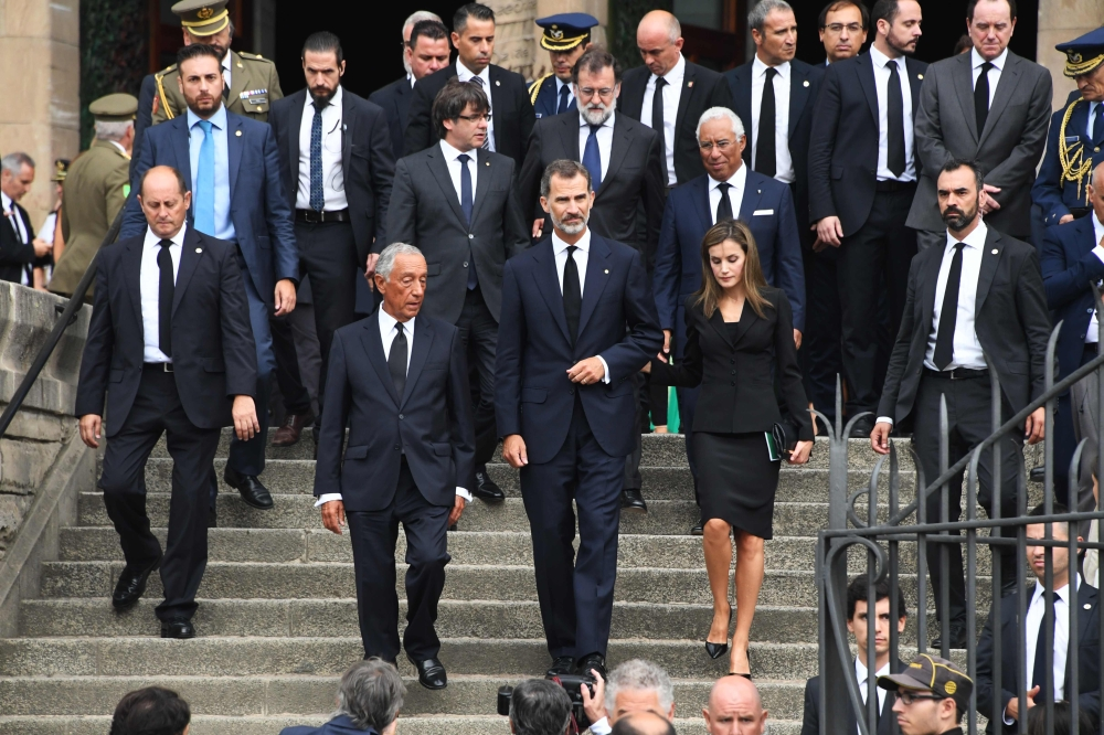 Spain's King Felipe VI, center, Queen Letizia, right, and Portugal's President Marcelo Rebelo de Sousa, left, leave after a mass on Sunday to commemorate victims of two devastating terror attacks in Barcelona and Cambrils, at the Sagrada Familia church in Barcelona.  — AFP