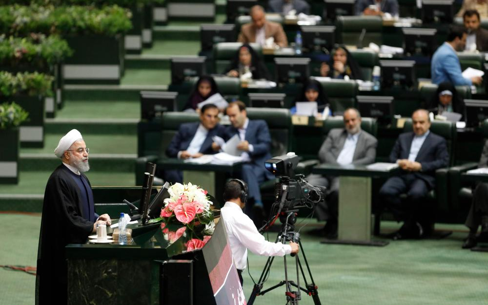 Iranian President Hassan Rohani speaks in parliament in Tehran, Sunday. — AFP