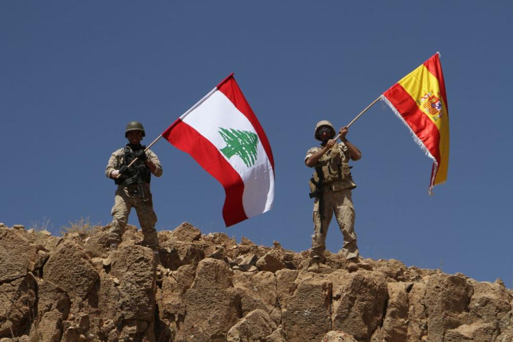 A handout picture released by the Lebanese army on Saturday shows Lebanese soldiers holding up the Lebanese and Spanish national flags at Mkhayrme Mountain in Ras Baalbek, in solidarity with Spain following the twin terror attacks in Barcelona and Cambrils. — AFP