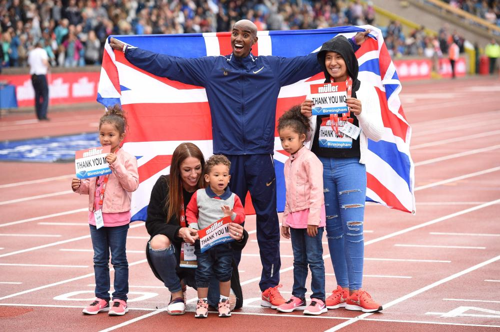 Britain's Mo Farah poses with his family after winning the men's 3,000m during the 2017 IAAF Birmingham Diamond League Athletics Meeting at Alexander Stadium in Birmingham Sunday. — AFP