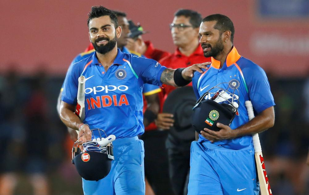 India's captain Virat Kohli (L) and Shikhar Dhawan celebrate their victory against Sri Lanka in the first One-Day International match at Dambulla Sunday. — Reuters