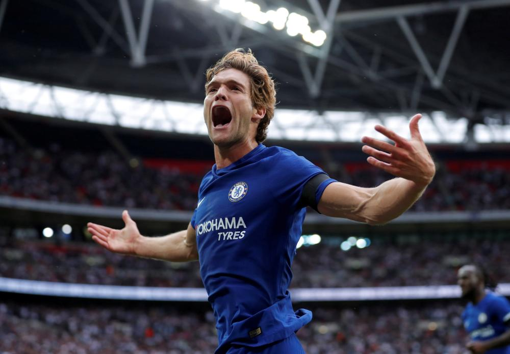 Chelsea's Marcos Alonso celebrates scoring their second goal against Tottenham Hotspur during their English Premier League match in London Sunday. — Reuters