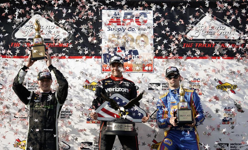 (L-R) Second place finisher Josef Newgarden, winner Will Power and third place finisher Alexander Rossi pose after the IndyCar auto race at Pocono Raceway in Long Pond Sunday. — AP