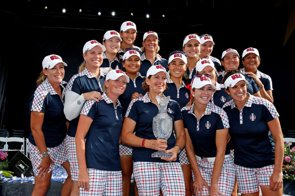 US players pose with The Solheim Cup at the closing ceremonies of the 2017 Solheim Cup at Des Moines Golf and Country Club in Iowa Sunday. — Reuters