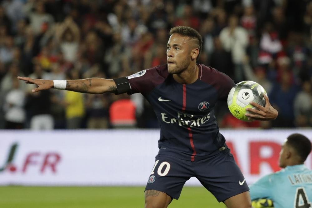 Paris Saint-Germain's Neymar celebrates after scoring a goal during the French L1 football match against Toulouse FC (TFC) at the Parc des Princes Stadium in Paris Sunday. — AFP