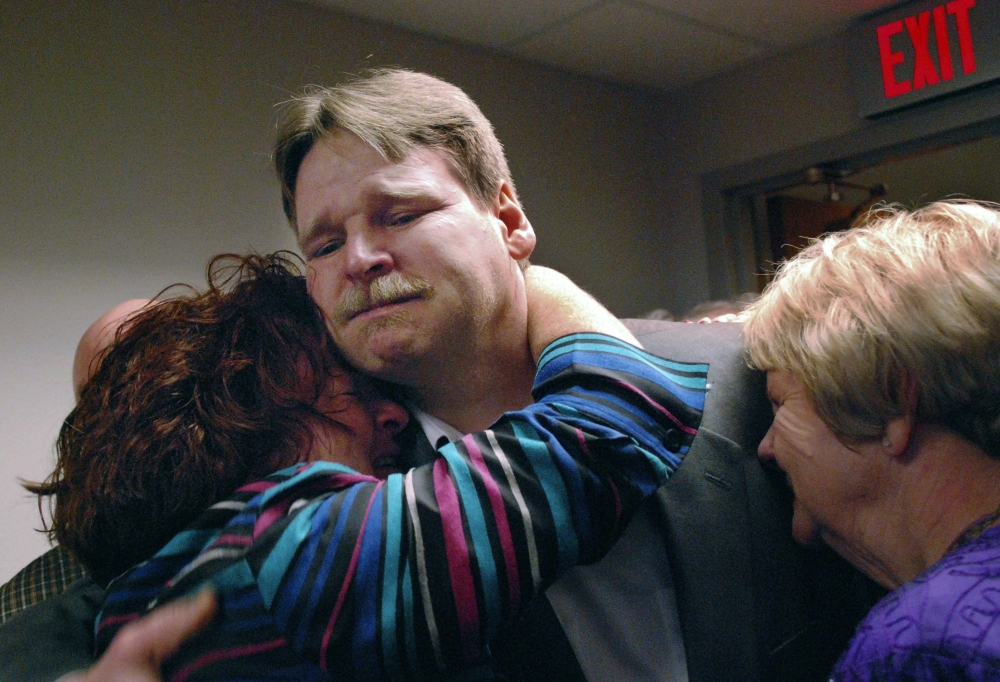 In this Nov. 25, 2008 file photo, Steven Barnes receives a hug from sister Lisa Pawloski, beside his mother Sylvia Bouchard, right, moments after Barnes was released from prison in Utica, New York. Family and friends packed the Oneida County Court room for the hearing where Judge Michael Dwyer overturned Barnes' 1989 conviction for the 1985 rape and murder of 16-year-old Kimberly Simon, based on new DNA evidence. - AP