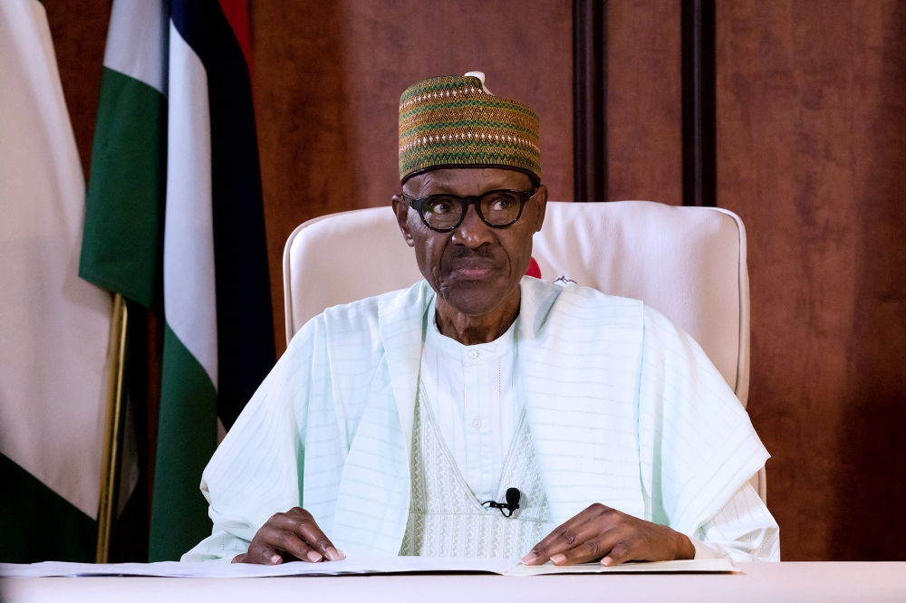 Nigeria's President Muhammadu Buhari delivers the first televised speech since returning home after three months of medical leave in Britain, in Abuja, Nigeria, on Monday. — Reuters