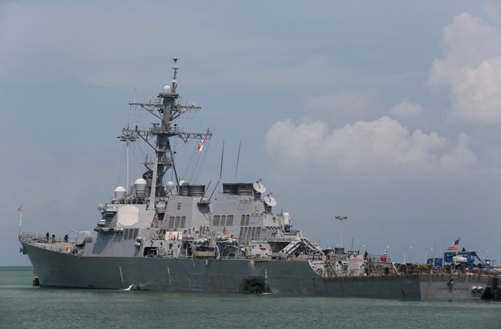 The guided-missile destroyer USS John S. McCain (DDG 56) is moored pier side at Changi naval base in Singapore following a collision with the merchant vessel Alnic MC on Monday. — AP