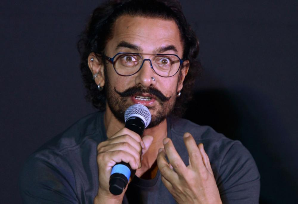 Bollywood actor Aamir Khan gestures during a news conference to launch the soundtrack of his new film