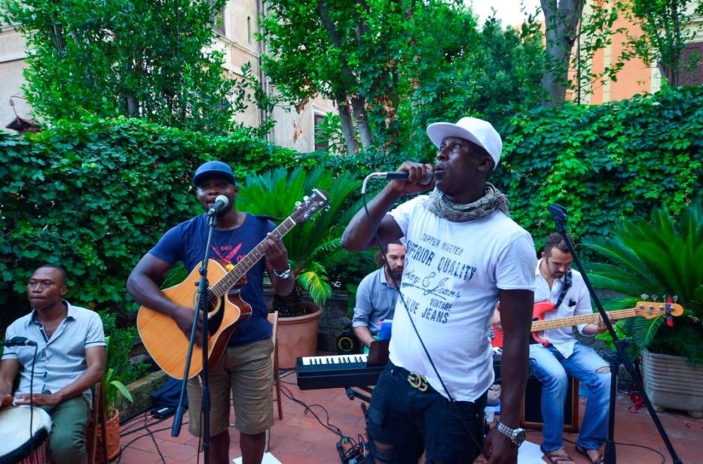 Ibrahim Jalloh of Sierra Leone sings during a performance of the Medu Music Band in Rome, Italy. - Reuters