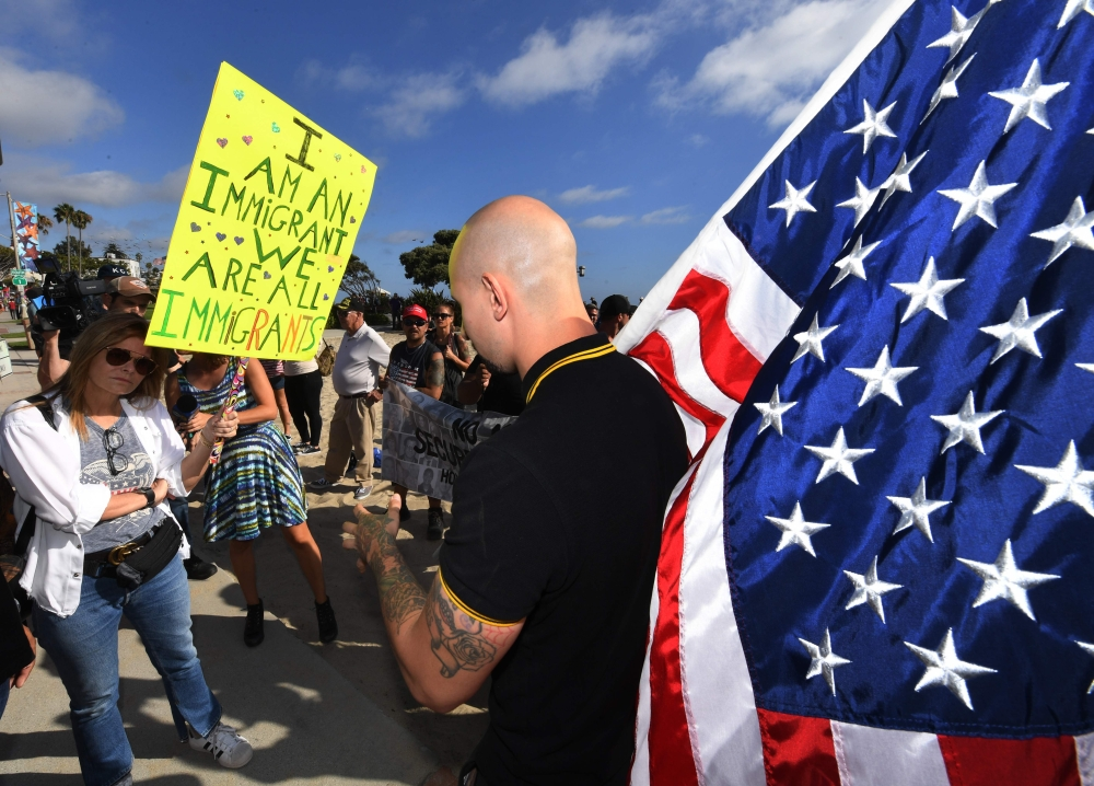 Counter-protesters, left, argue with Trump supporters in Laguna Beach, California, on Monday. — AFP
