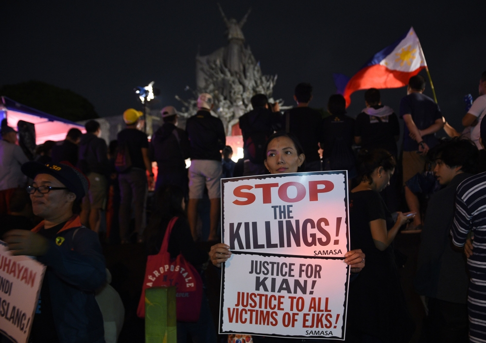 Protesters take part in a demonstration against the killings of suspected drug users allegedly by police during anti-drugs raids in Manila on Monday. — AFP