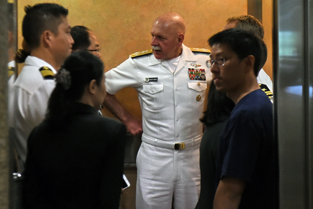 Admiral Scott Swift, center, commander of the US Pacific Fleet, arrives at the Singapore General Hospital on Tuesday to visit four injured US sailors from the guided-missile destroyer USS John S. McCain (DDG-56) following a collision on Monday off the coast of Singapore. — AFP