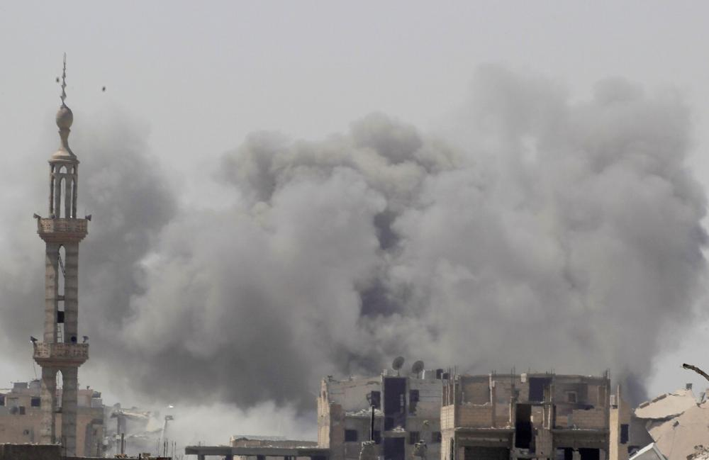 Smoke rises after an airstrike during fighting between members of the Syrian Democratic Forces and Daseh (the so-called IS) militants in Raqqa. — Reuters