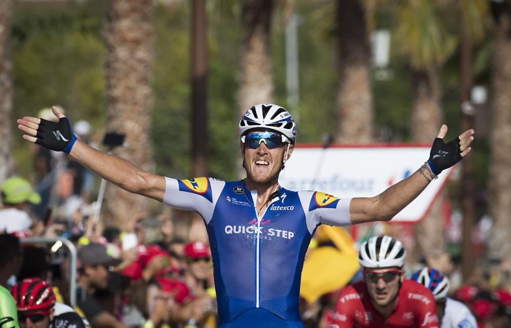 "Quick-Step Floors Team's Italian cyclist Matteo Trentin celebrates as he crosses the finish line to win the 4th stage of the 72nd edition of ""La Vuelta"" Tour of Spain cycling race, a 198,2km route between Escaldes-Engordany to Tarragona in Spain Tuesday. — AFP"