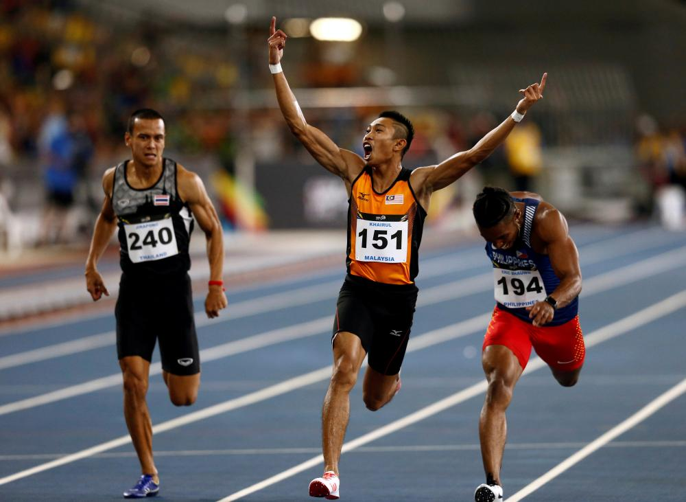 Khairul Hafiz Jantan of Malaysia wins the men's 100m final at the Southeast Asian Games in Kuala Lumpur Tuesday. — Reuters