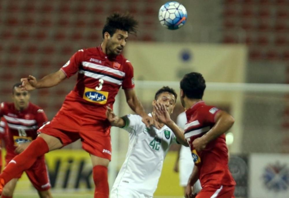 A keen duel during the 2017 AFC Champions League quarterfinal match between Iran's Persepolis and Saudi Arabia's Al-Ahli in Muscat Tuesday. — AFP