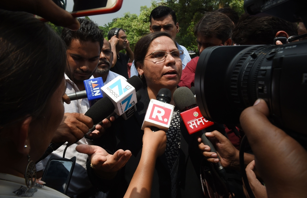 Advocate Farha Faiz speaks to the media outside the Supreme Court in New Delhi, Tuesday. India's top court banned a practice that allows men to divorce their wives instantly, ending a long tradition that many Muslim women had fiercely opposed. — AFP