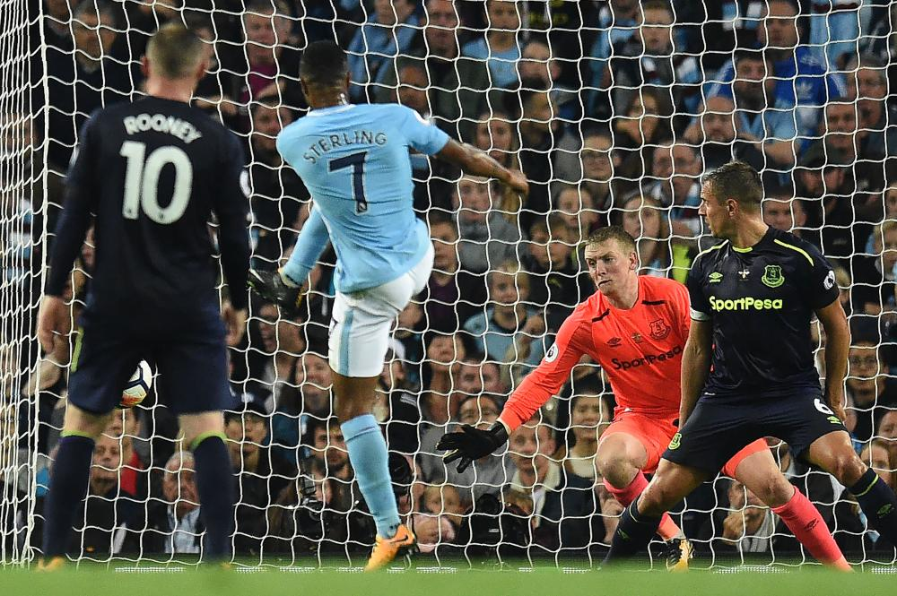 Manchester City's English midfielder Raheem Sterling (2nd L) scores the equalizer against Everton during their English Premier League match at the Etihad Stadium in Manchester Monday. — AFP