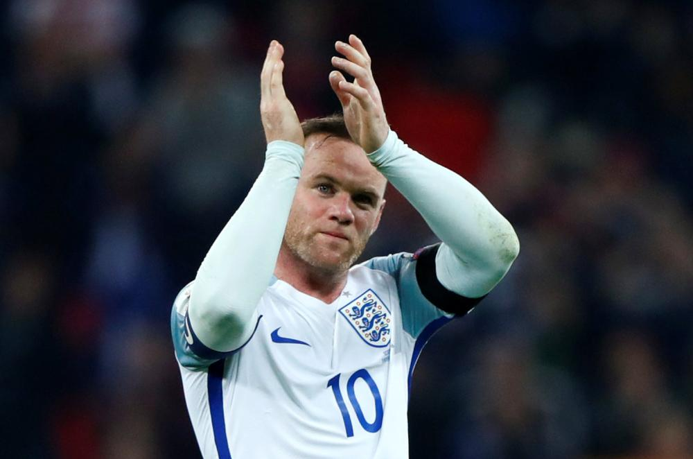 Wayne Rooney of England applauds fans after the 2018 World Cup qualifying game against Scotland at the Wembley Stadium in London on Nov. 11, 2016. — Reuters