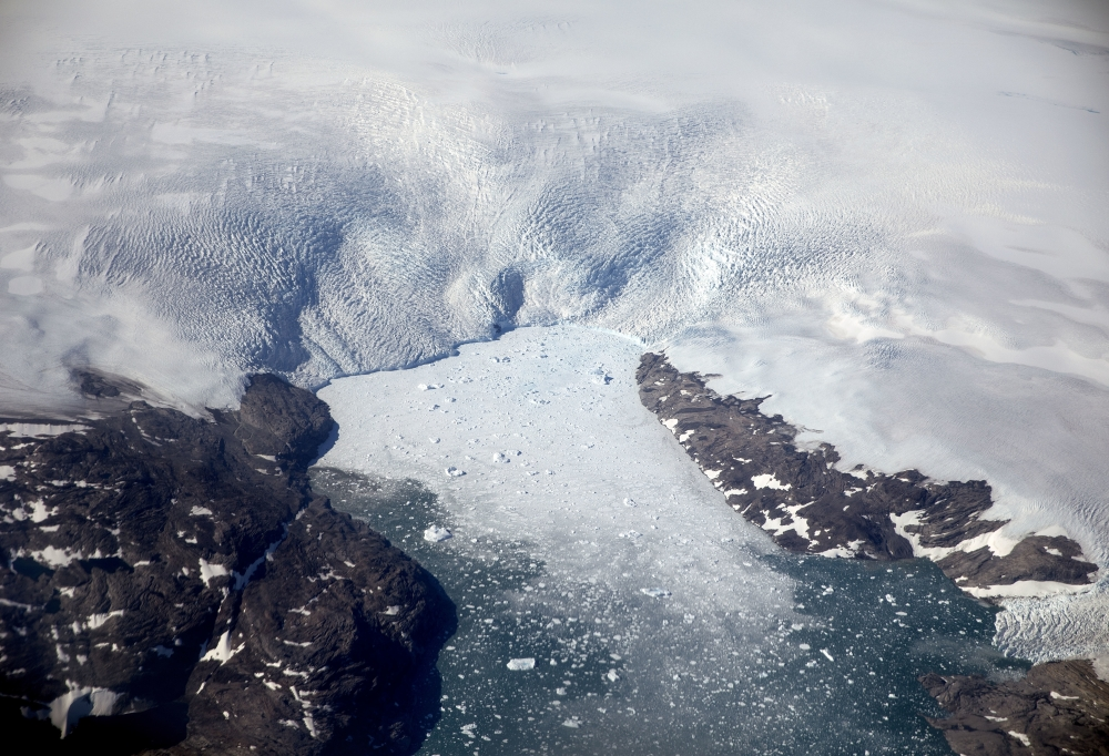 A glacier calves icebergs into a fjord off the Greenland ice sheet in southeastern Greenland in this Aug. 3, 2017 file photo. The Greenland ice sheet, the second largest body of ice in the world which covers roughly 80 percent of the country, has been melting and its glaciers retreating at an accelerated pace in recent years due to warmer temperatures. - AP