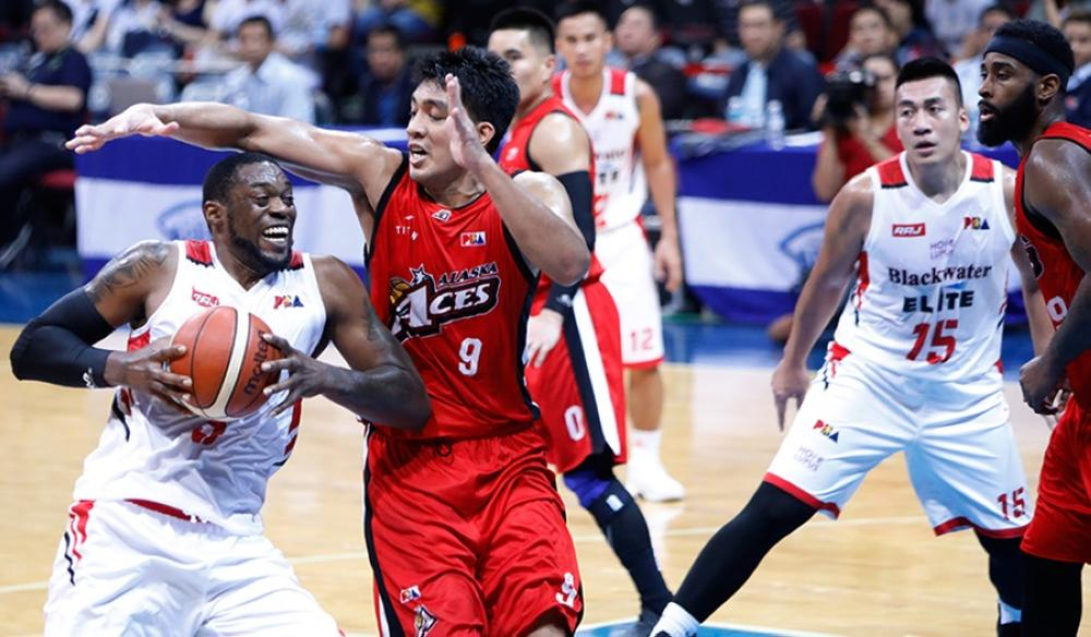 Blackwater's Bill Walker bucks the defense of Alaska's Jaypee Mendoza as he goes for a drive in their PBA Governors' Cup game at the Mall of Asia Arena Wednesday night.