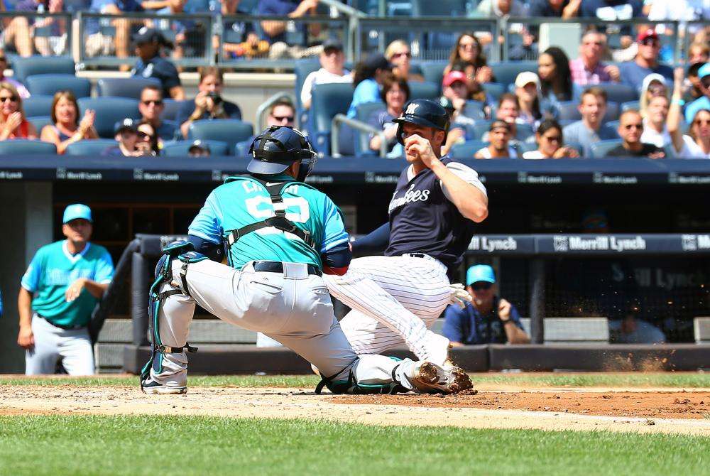 New York Yankees' first baseman Greg Bird is tagged out at home plate by Seattle Mariners' catcher Carlos Ruiz during their MLB game at Yankee Stadium in New York Saturday. — Reuters.