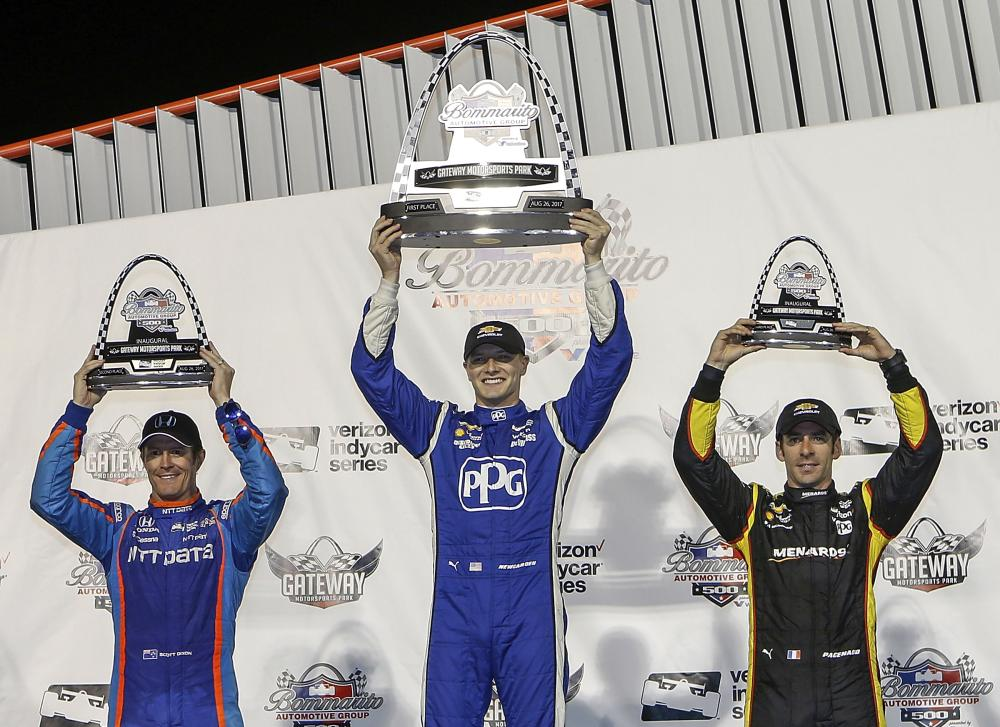 Josef Newgarden (C) celebrates his win, while standing next to second-place Scott Dixon (L) of New Zealand and third-place Simon Pagenaud of France after the IndyCar auto race at Gateway Motorsports Park in Madison Saturday. —AP