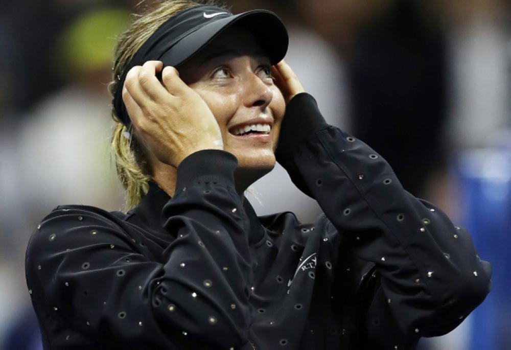US Open: Maria Sharapova makes emotional comeback, beats Simona Halep