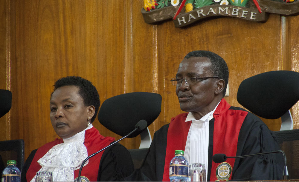 Kenyan Supreme Court Chief Justice of David Maraga (right) delivers the election petition judgement, watched by Judge Philomela Mwilu, in Nairobi on Friday.  — AFP
