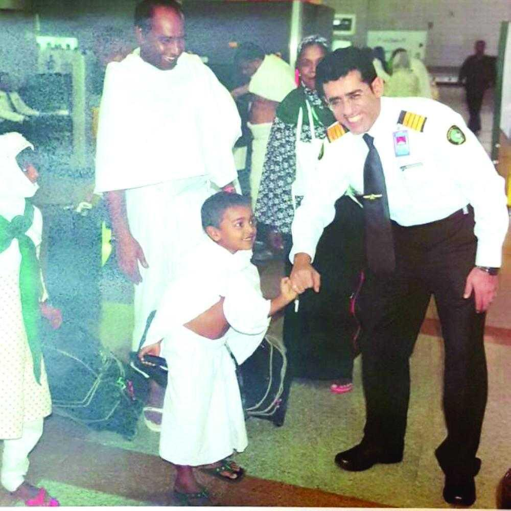 A Saudi Customs officer is seen welcoming a pilgrim and his son for this year's Haj. — courtesy photo