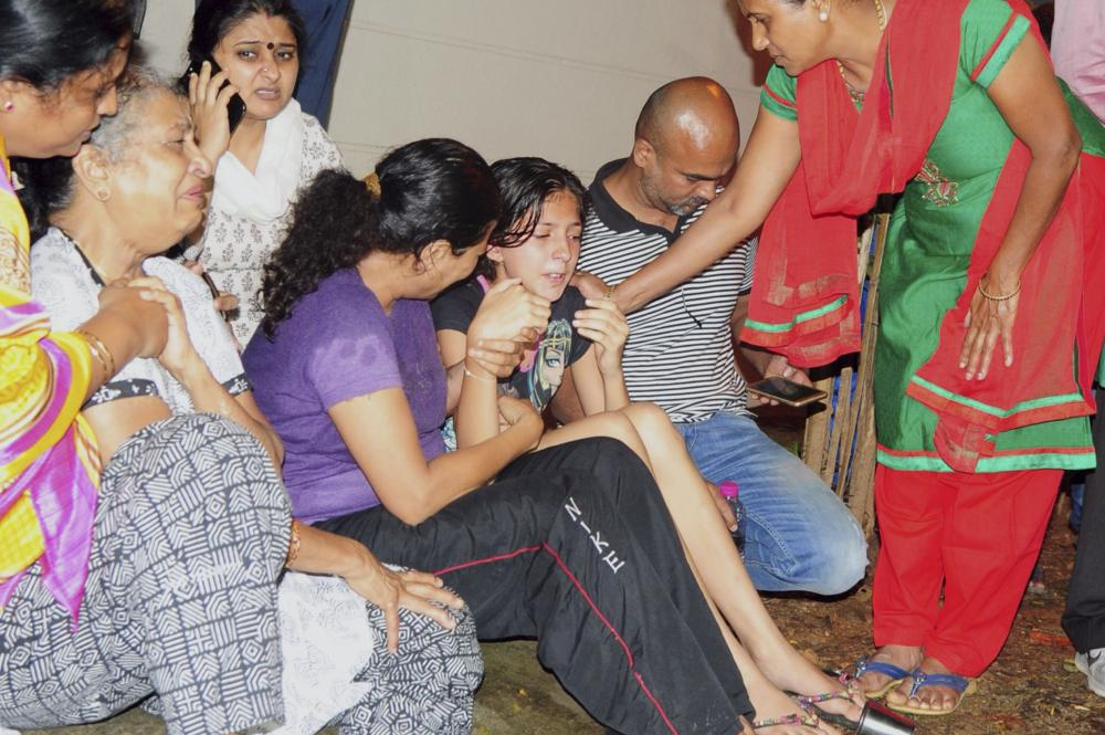 Family members and relatives of 55-year-old Gauri Lankesh, who was shot dead by unknown assailants in the porch of her home in Bangalore mourn her death. Gauri Lankesh was a senior journalist known for her Leftist and anti-Hindutva views and for her criticism of Hindu extremism. — AFP