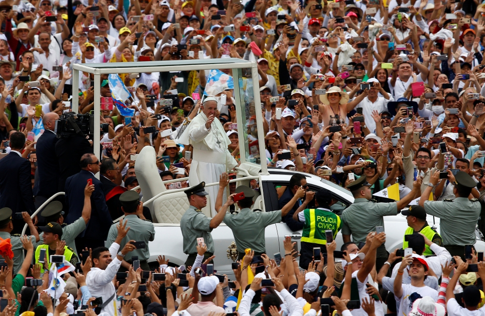 Pope Francis waves to the faithfuls as he arrives in the popemobile to a holy mass in Villavicencio, Colombia, on Friday. — Reuters