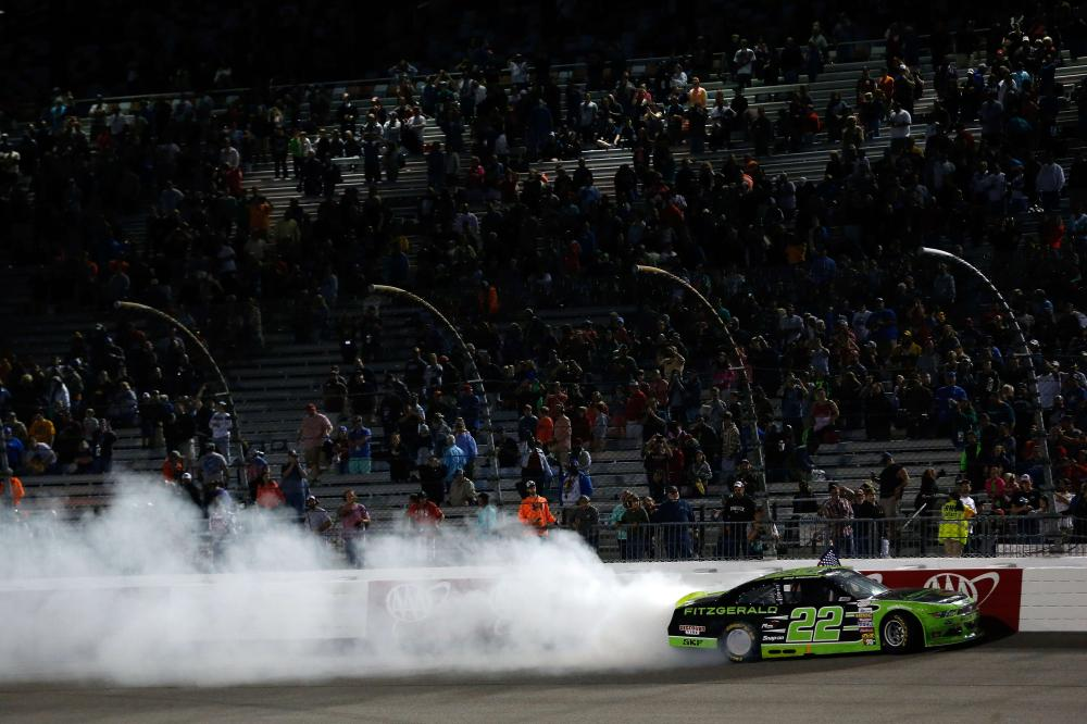 Brad Keselowski, driver of the #22 Fitzgerald Glider Kits Ford, celebrates after winning the NASCAR Xfinity Series Virginia529 College Savings 250 at Richmond International Raceway Friday. — AFP
