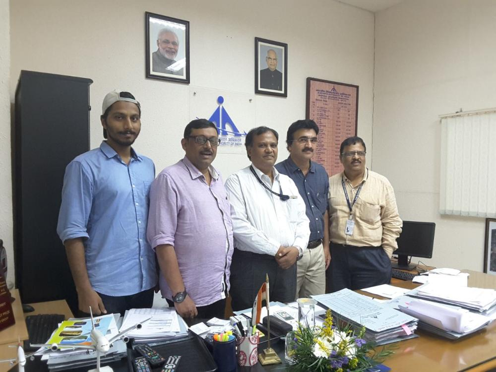 Malabar Development Forum President K.M. Basheer, Chief Coordinator T.P.M. Hashirali and other officials meet J.T. Radhakrishna, director of Kozhikode International Airport, recently. — Courtesy photo